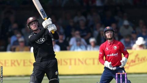 Surrey's Jason Roy (left) hits a six