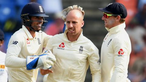 England players Ben Foakes, Jack Leach and Jos Buttler celebrate after Leach dismisses Sri Lanka's Dilruwan Perera