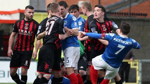 Just five points between leaders Crusaders and Linfield with three games remaining and tempers flare in the Seaview showdown