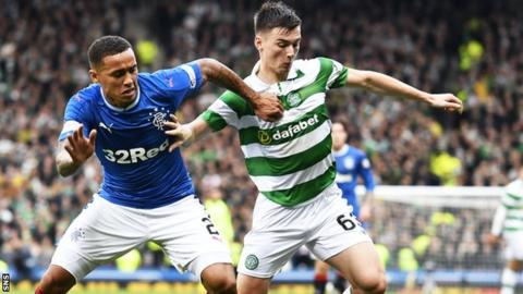 Rangers attacking full-back James Tavernier tussles for possession with Celtic's Kieran Tierney