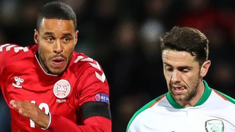 Robbie Brady battles with Denmark's Mathias Jorgensen