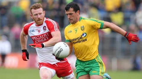 Derry midfielder Fergal Doherty moves in to challenge Frank McGlynn of Donegal at Clones
