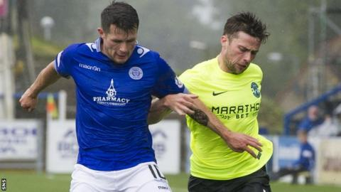Queen of the South's Dale Hilson (left) with Lewis Stevenson
