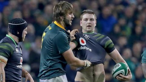 Iain Henderson indulges in a spot of jersey putting with South Africa's Load de Jager