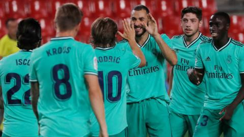 Real Madrid's players celebrate scoring against Granada