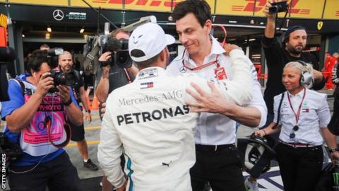 Mercedes boss Toto Wolff congratulates driver Lewis Hamilton