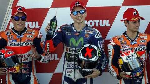 Jorge Lorenzo (centre) celebrates pole