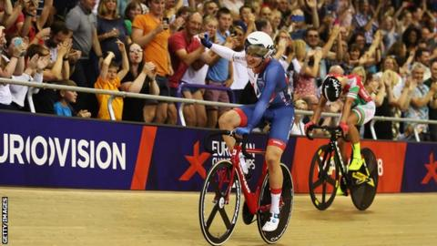 Ethan Hayter waves to the crowd after winning omnium European gold