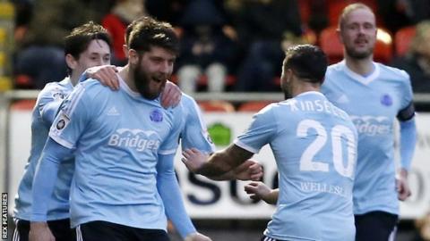 Will Evans (left) celebrates a goal for Aldershot