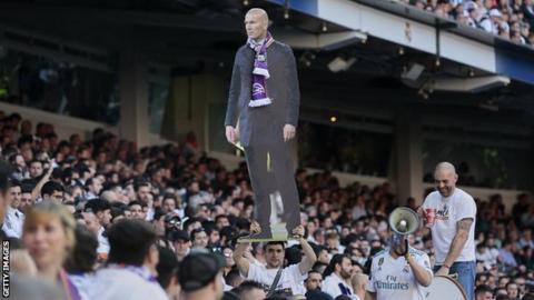 Real Madrid fan holds aloft Zidane cut-out
