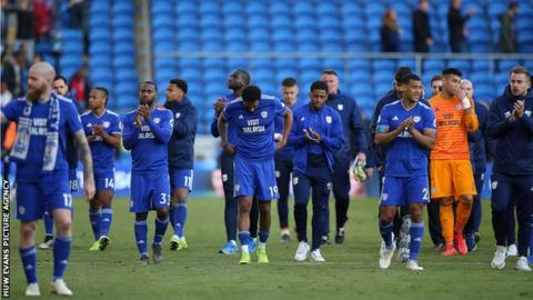Dejected Cardiff players salute their fans after the loss to Palace confirmed their return to the Championship