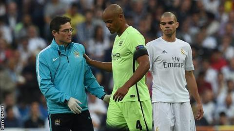 Vincent Kompany is helped off the pitch as Pepe looks on