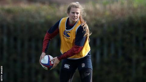 Zoe Harrison passes the ball in training
