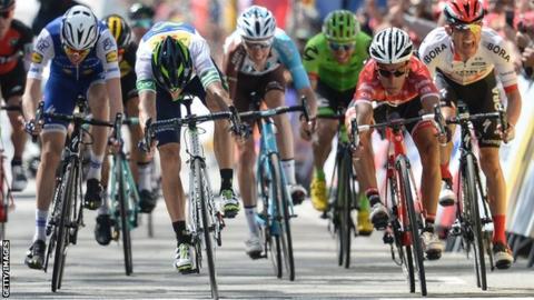 Alejandro Valverde (second left) crosses the line on Sunday