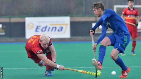 Banbridge's Philip Brown attempts to fire the ball past Alex Moffet in the Irish Cup quarter-final