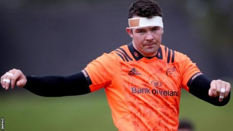 Peter O'Mahony limbers up during a Munster training session on Monday