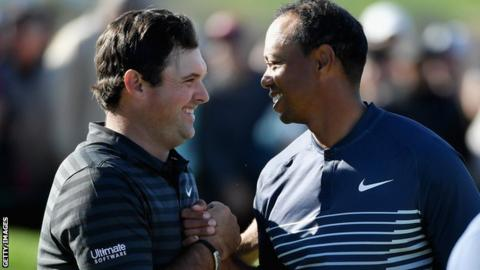 Tiger Woods (right) shakes hands with Patrick Reed