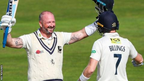Darren Stevens celebrates his double century for Kent with Sam Billings