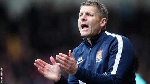 Northampton caretaker manager Dean Austin encourages his players
