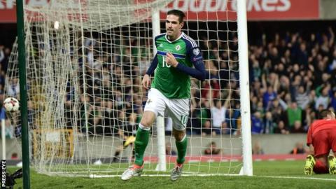 Kyle Lafferty runs away in celebration after scoring Northern Ireland's second goal against San Marino