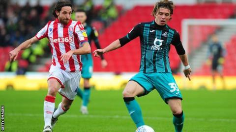Stoke City's Joe Allen in action against Swansea City's Conor Gallagher