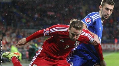 Wales' Chris Gunter and Bosnia and Herzegovina's Tino-Sven Susic tussle