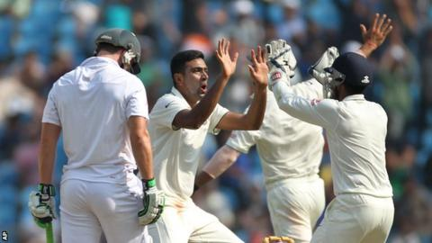 Ravichandran Ashwin (centre) celebrates a wicket
