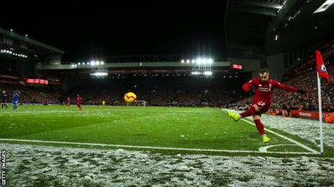 A general view of Anfield as Liverpool's Xherdan Shaqiri takes a corner against Leicester as the snow falls during a Premier League match