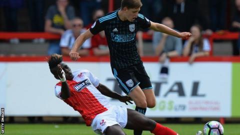 Elton Ngwatala tackles Sam Field