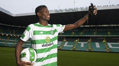 Vakoun Issouf Bayo takes a selfie of himself in his Celtic shirt