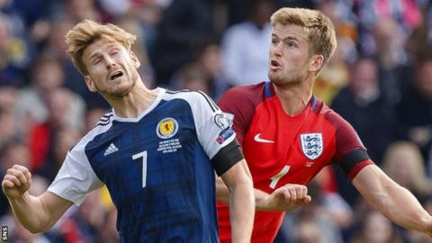 Stuart Armstrong and Eric Dier contest possession