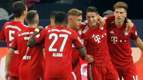Bayern Munich's players celebrate scoring against Schalke