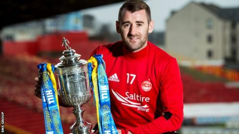 Aberdeen winger Niall McGinn poses with the Scottish Cup at Pittodrie