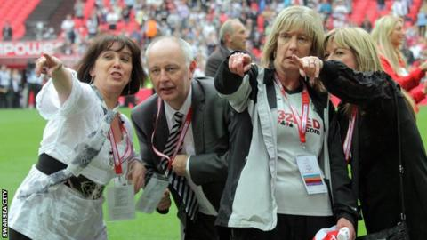 Jackie Rockey celebrates at Wembley with other Swansea City staff