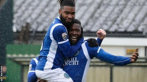 Nathan Blissett is congratulated by Macc team-mate Tyrone Marsh after scoring one of his five goals on loan from Plymouth last season