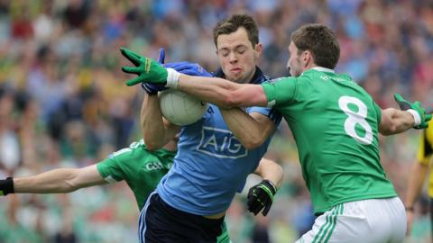Dean Rock of Dublin attempts to shrug off the challenge of Fermanagh pair Mickey Jones and Eoin Donnelly
