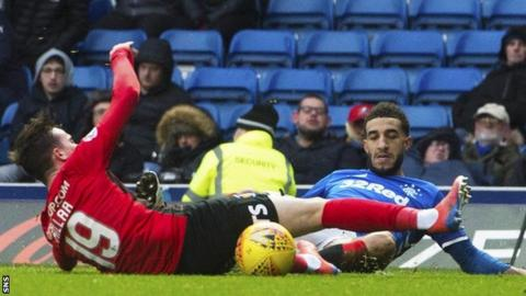 Kilmarnock's Liam Millar is pulled down by Rangers' Connor Goldson