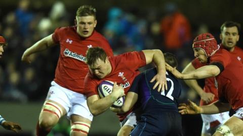 Dewi Lake is tackled by Robbie McCallum
