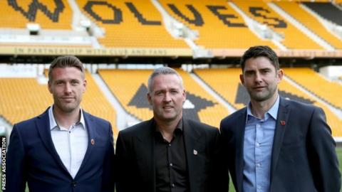 Paul Lambert and Wolves' new backroom team of Rob Edwards (left) and Stuart Taylor