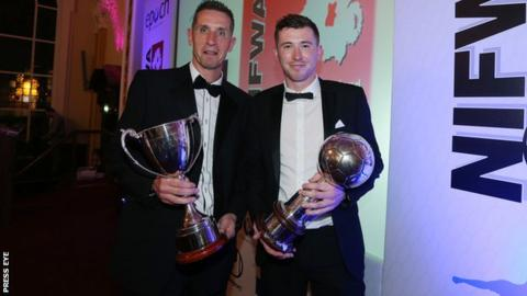 Crusaders boss Stephen Baxter and Billy Joe Burns with their awards at Belfast City Hall