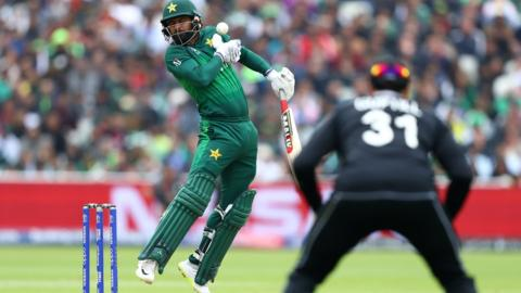 Mohammad Hafeez tries to evade a bouncer