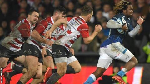 Marland Yarde races away from the Gloucester defence to score a try for Sale Sharks