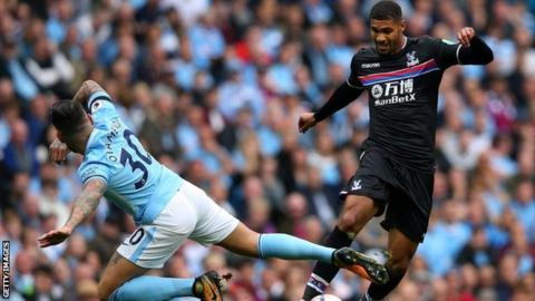 Ruben Loftus-Cheek of Crystal Palace and Nicolas Otamendi of Manchester City