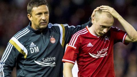 Derek McInnes consoles Willo Flood after defeat by Real Sociedad