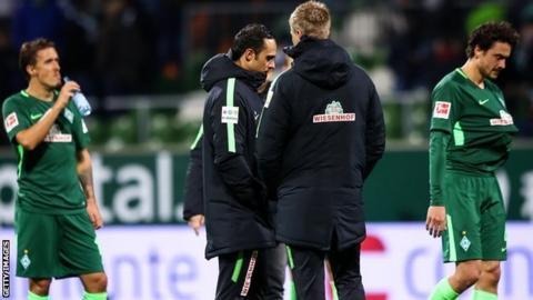 Alex Nouri and Werder Bremen players following a 3-0 defeat to Ausburg