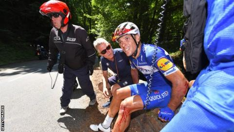Philippe Gilbert at the side of the road after a fall during the 16th stage of the race