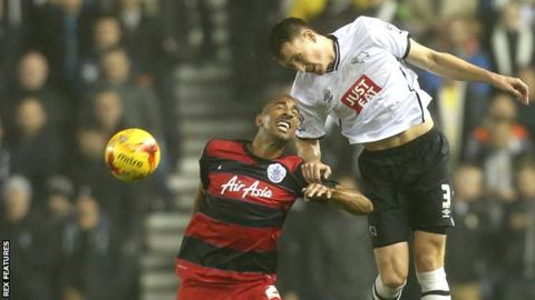 Craig Forsyth (right) challenges QPR's Karl Henry