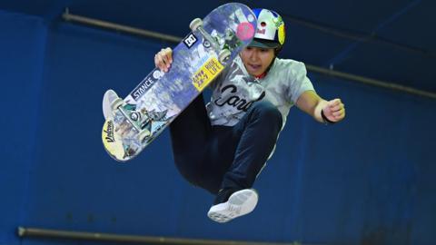 Tokyo, Japan. 13 May: Yuzuki Kamide of Japan competes during the Japan Skateboarding Championships at Murasaki Park in Tokyo.