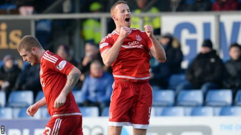 Adam Rooney celebrates scoring for Aberdeen