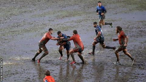 Newport Gwent Dragons take on Newcastle Falcons on a water-logged Rodney Parade pitch